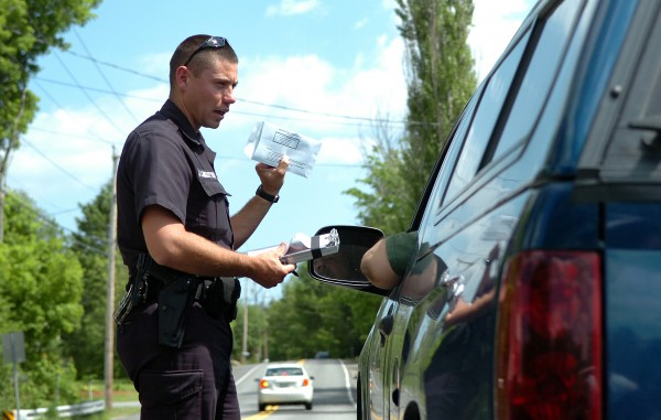 Bangor Police Officer Jason Linkletter gives a ticket to Stephen Look of Glenburn for failure to wear his seat belt while driving on Kenduskeag Avenue in Bangor in May 2010.