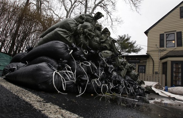 A pile of sandbags sits in the parking lot of a restaurant not far from the Delaware River in Yardley, Pa., Thursday, March 10, 2011. Flood watches are in effect across much of Pennsylvania as rain moves into the state, threatening to raise already swollen waterways out of their banks.