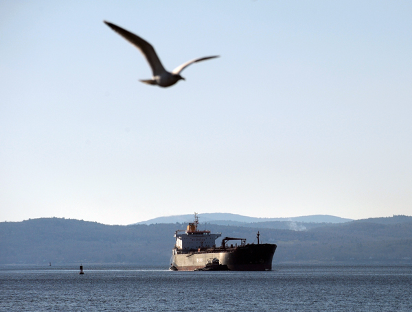 A ship is guided into the Sprague Energy Terminal at Mack Point by tugboats off Searsport. A Denver-based company hopes to build a terminal in Searsport that would draw its propane supply from ships like this before transferring propane to trucks that would ship the fuel throughout the state.