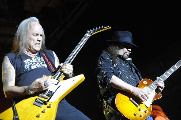 Ricky Medlocke (left) and Gary Rossington of Lynyrd Skynyrd share guitar licks at the beginning of their concert in front of thousands of devoted fans on Bangor's waterfront on August 5, 2010.