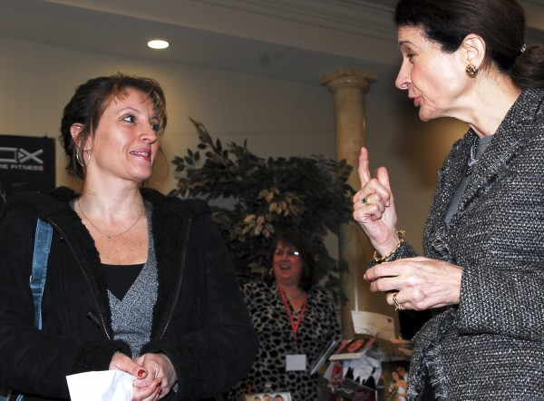 Sen. Olympia J. Snowe, R-Maine, chats with Lori Brogan of Portland at a job fair in Portland on Tuesday, March 22, 2011. Brogan was at the job fair for 5 minutes and quickly got an interview scheduled for later in the week.