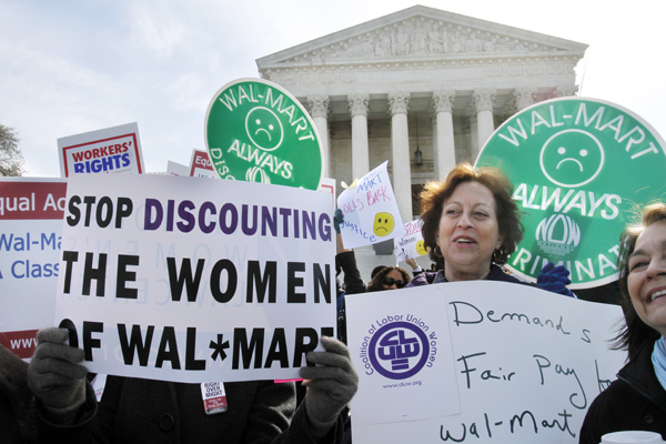 Carol Rosenblatt of Washington (right), and others, take part in rally outside the Supreme Court in Washington, Tuesday in support of the plaintiffs in a case of women employees against Wal-Mart