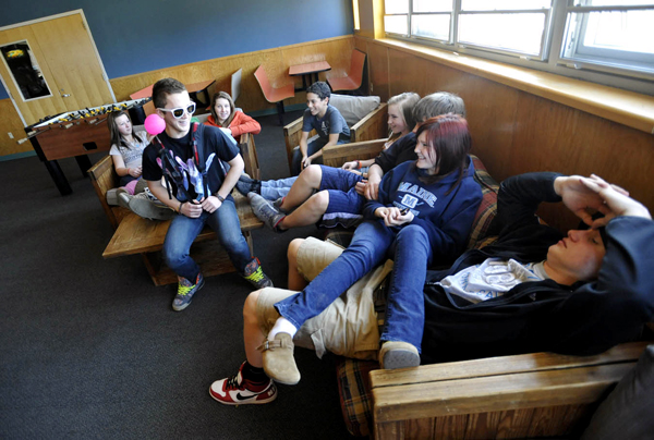 Chris Williams, 15 (seated on coffee table, wearing sunglasses) gets a rise out of his Belfast Area High School schoolmates and others in the Teen Room of the Waldo County YMCA after school Friday afternoon. The Waldo County YMCA serves 15 municipalities in Waldo County. Officials in a some Maine munipalities are opting not to fund social service agencies such as area YMCAs.