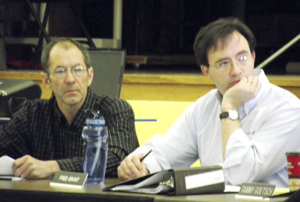 Bruce Clark (left), and Fred Grant, two members of the SAD 29 school board, listen to testimony from citizens of Littleton and Monticello on Tuesday during a special school board meeting at the Wellington School in Monticello. The meeting was called so that board members could hear data related to the possible closure of the 60-year-old educational facility. After impassioned pleas from the public and concern that closing the school would not save a substantial amount of money, the board decided to drop the matter and keep the school open.