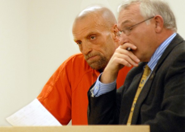 Dennis Wood, 46, of Bangor during his first appearance at the Penobscot Judicial Center in Jan. 2011 on charges of possession of a firearm by a felon, domestic assault, two counts of assault and violation of a protection order. Woods stands by defense attorney James Diehl.
