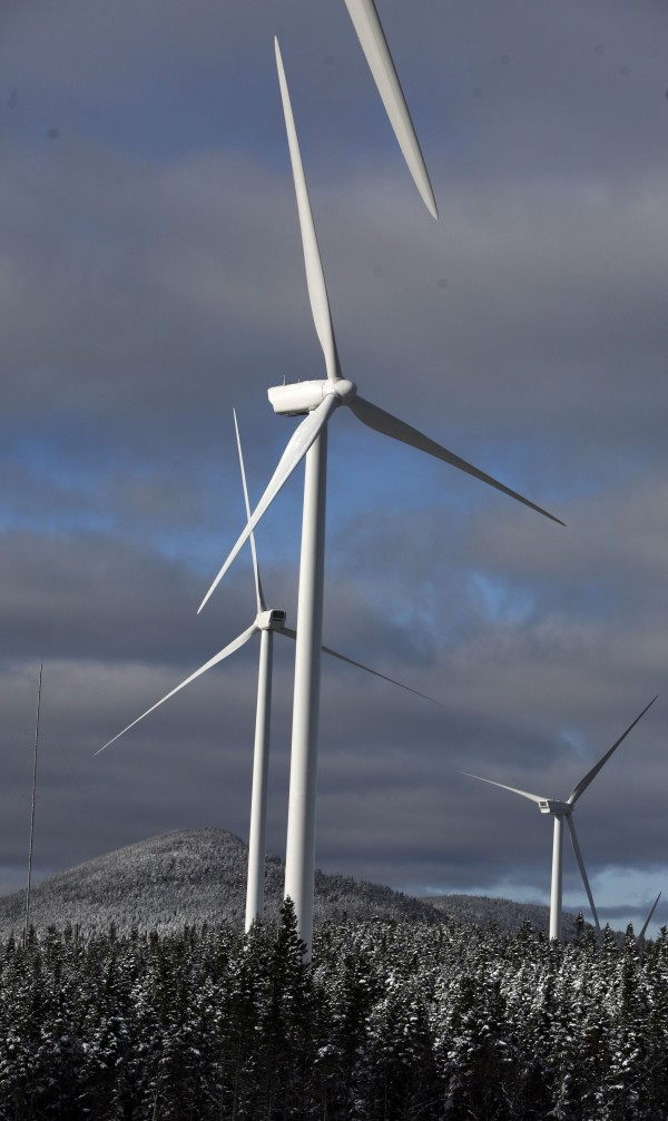 With five commercial-grade wind farms running or under construction and more on the drawing board, some Maine residents are challenging the state law that expedites the permitting process for setting up a wind farm. These turbines are along the Kibby Mountain Range in western Maine in 2009.