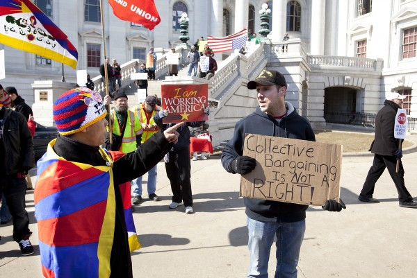 Protests continue in Wisconsin over the governor's proposal to eliminate collective bargaining for state employees.