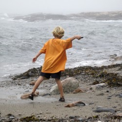 Ben Goldstein, 7, of Bar Harbor, skips rocks off the beach reached by Wonderland Trail in Bar Harbor.