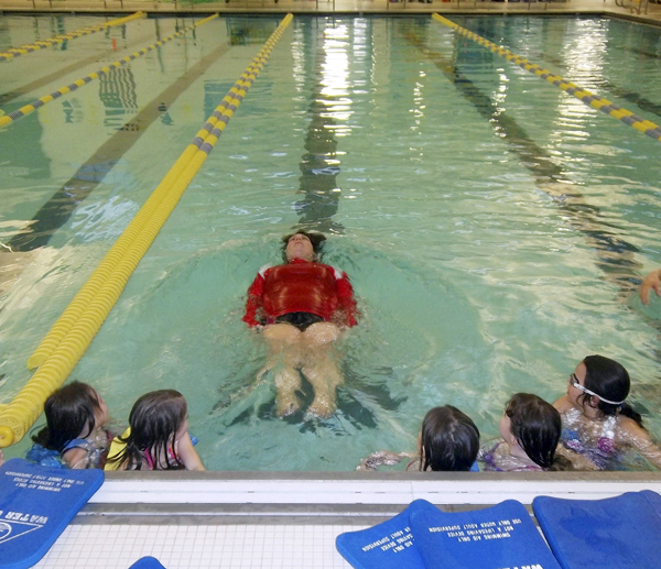 Penobscot Bay swim instructor Andrea Penney teaches children to float at the YMCA in Rockport.