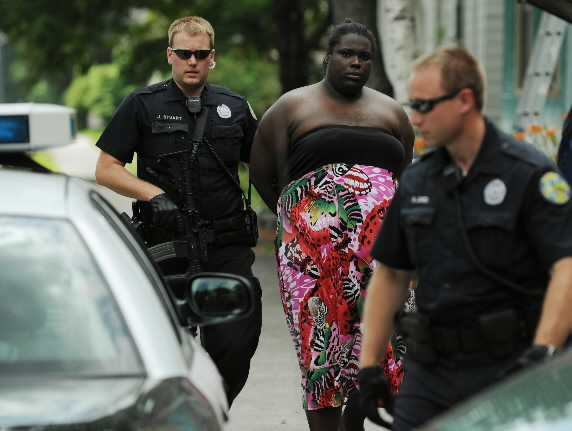 Bangor police Officers Jason Stuart (left) and Ryan Jones escort Matisha Marie Pitts from an apartment at 86 Kenduskeag Ave. to a waiting police car in July 2010.