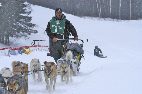 Rene Marchildon of South River, Ontario, toughed out three days of rain, near blizzards and exhaustion to win his first Irving Woodlands Can Am Crown International 250 Mile Sled Dog Race Monday afternoon. &quotMy dogs pulled their freaking hearts out,&quot Marchildon said after crossing the finish line in Fort Kent Monday afternoon.