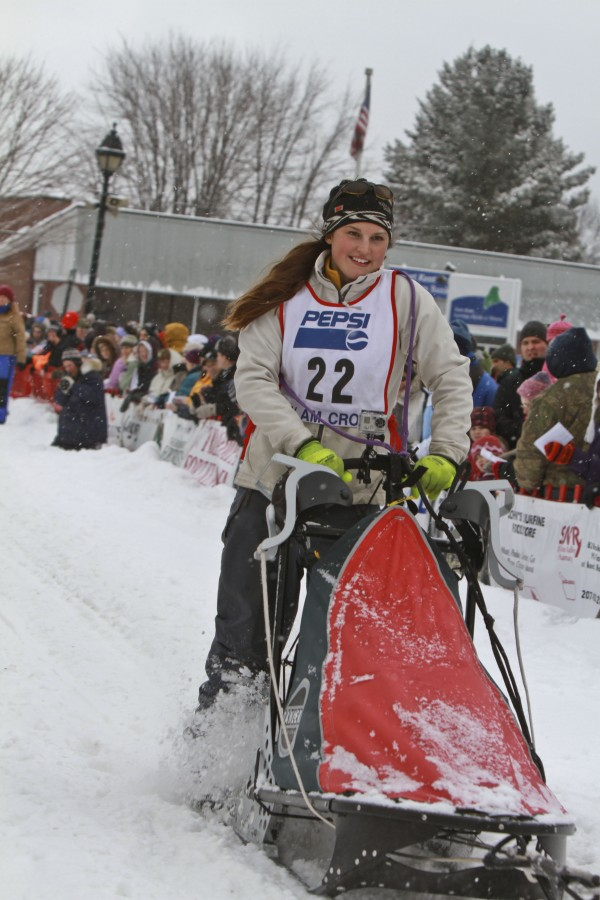 21-year-old Amy Beth Dionne from St David, Maine, drives her sled team down a crowded lined Main Street in Fort Kent  Saturday at the start of the Can Am Crown 30 mile sled Dog race. Dionne placed second in the race with a time of 3 hours, 9 minutes, 39 seconds. This is Dionne's second year of racing