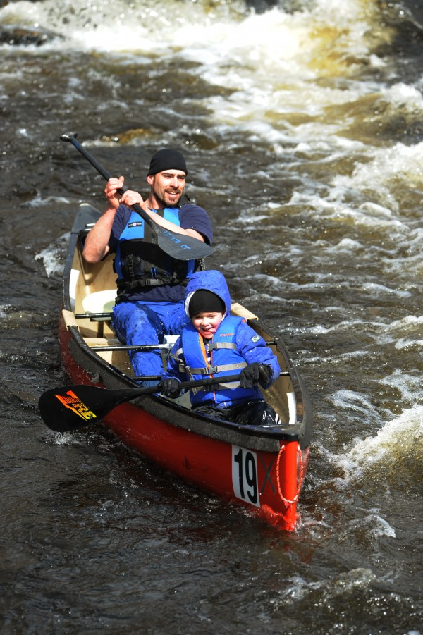 Young Jack Burke enjoys his first canoe race with his father, J.D. Burke, of Newburgh during the 32nd annual St. George River race on Saturday in Searsmont.