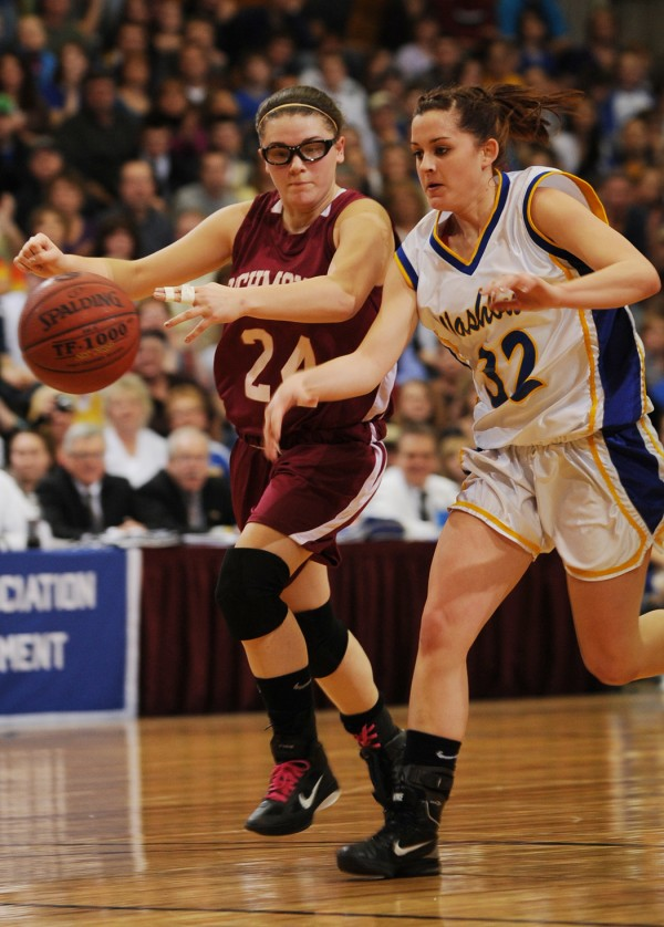Washburn's Meghan Saucier has the ball slapped away during a drive to the basket by Richmond's Payton Johnson during the Girls Class D state Championship at the Bangor Auditorium on Saturday, March 5, 2011. Washburn won.