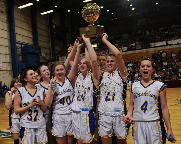 The Washburn girls basketball team hold the gold ball aloft after defeating Richmond at the Bangor Aduitotium on Saturday, March 5, 2011 during the Girls Class D State Championship.