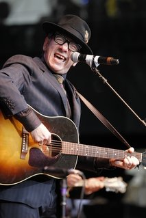 Elvis Costello performs during a Bridge School Benefit concert in Mountain View, Calif., Oct. 24, 2010.