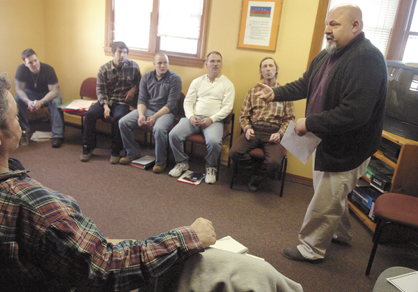 Counselor Bruce Gardner, far right, leads a group therapy session on Wednesday, March 9, 2011, at Wellspring's residential substance-abuse treatment facility for men in Bangor. State budget cuts may force Wellspring and similiar area treatment facilities to severely curtail or even terminate services in the upcoming fiscal year. Wellspring also has a treatment facility for women as well as offering outpatient treatment services.