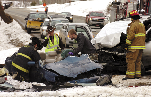 Emergency crews work to remove Louise Boudreau-Bouchard from her vehicle after she was hit head on by a SUV driven by William Hinkle while heading northbound on Rt. 1A in Frankfort around 9am on Wednesday, March 23, 2011. Boudreau-Bouchard was taken to Eastern Maine Medical Center in Bangor by LifeFlight of Maine, while Hinkle was transported to EMMC by ambulance.
