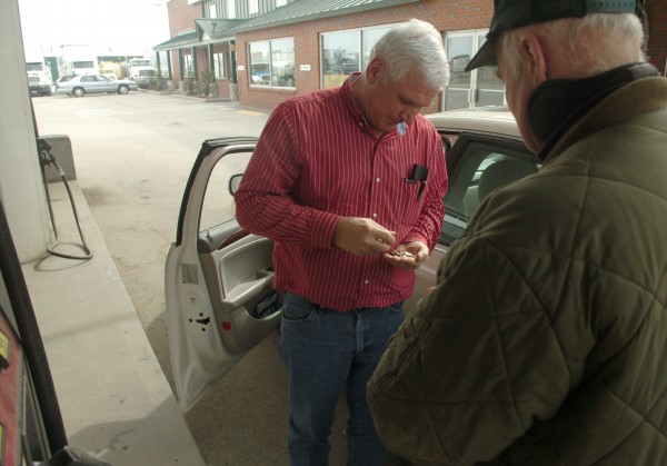 Carl Gendreau (left) of Madawaska, counts out coins to pay fuel attendant Gary Dalrymple at Dysart's Truck Stop and Restaurant in Bangor on Monday, March 13, 2011. Gendreau has recently curtailed his travel habits due to the high gas prices. &quotEverything goes up but our wages,&quot he said.