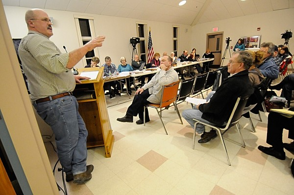 Peter Brown (left) made his public comments to the Hampden town council and other concerned residents when the town's updated comprehensive plan came up on the agenda Monday evening, March 7, 2011. &quotThe tone of the comprehensive plan leans towards a liberal agenda,&quot said Brown.