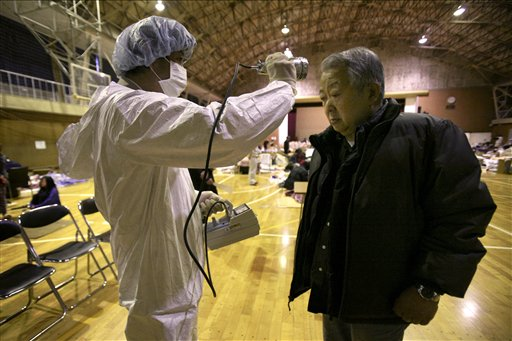 A man is screened for radiation exposure at a shelter after being evacuated from areas around the Fukushima nuclear facilities Wednesday.