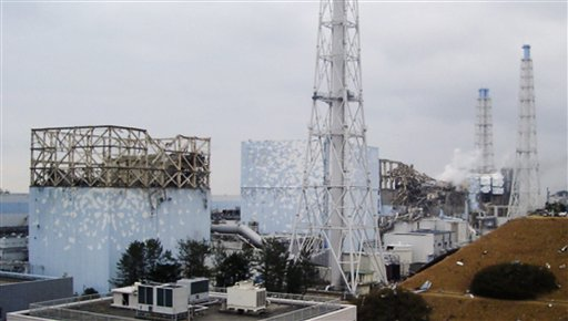 Smoke billows from the No. 3 unit among four housings cover four reactors at the Fukushima Dai-ichi nuclear complex Tuesday.