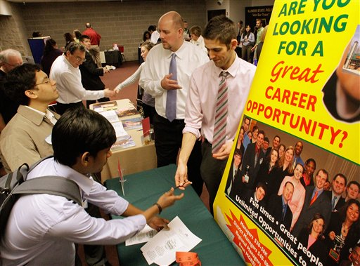 Businesses solicit students as they fill out job applications during the Springfield Collegiate Career Job Fair at the University of Illinois Springfield, in Springfield, Ill. The number of people requesting unemployment benefits last week plunged to a nearly three-year low, bolstering hopes that companies will hire more this year.