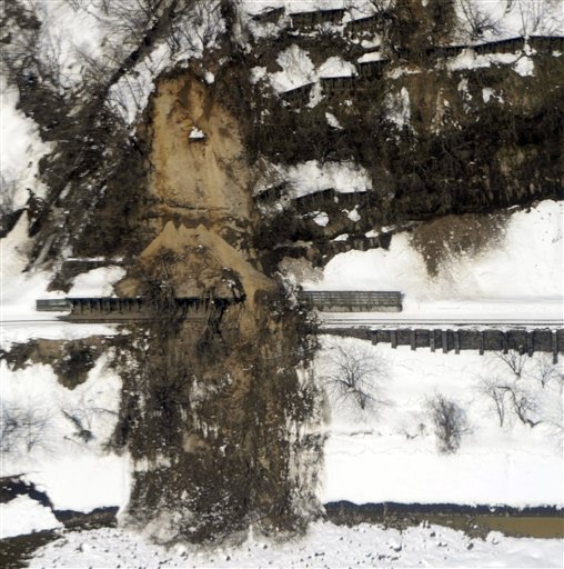Landslide covers train tracks near Echigotanaka Station in Niigata prefecture (states), Japan, Saturday, March 12, 2011, a day after one of the country's strongest earthquakes ever recorded hit its eastern coast.