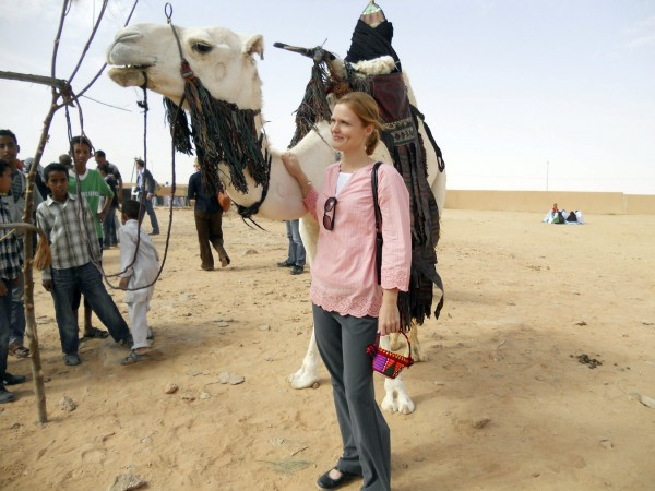 April Perkins is pictured with a camel in Ghadames during a recent cultural exhibition.  Perkins, a Bangor native and U Maine alumna, was evacuated with other Americans from Libya on Monday due to the political unrest there.