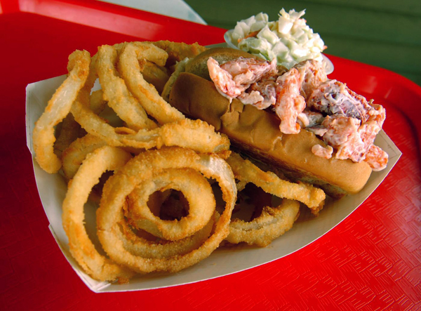 A lobster roll basket with onion rings and coleslaw from Dana's Grill at Dockside in Hampden.