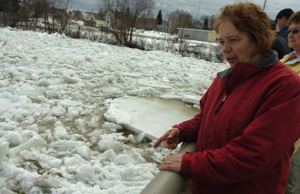 Christine Gordon of Mattawamkeag points to the large pieces of ice jamming the Mattawamkeag River on Sunday, March 13, 2011. Gordon, who lives close to the river on the town's Main Street, was among the spectators who gathered on the bridge Sunday afternoon to observe the ice. &quotThe water comes up every year, but I've never seen ice like this,&quot Gordon remarked.