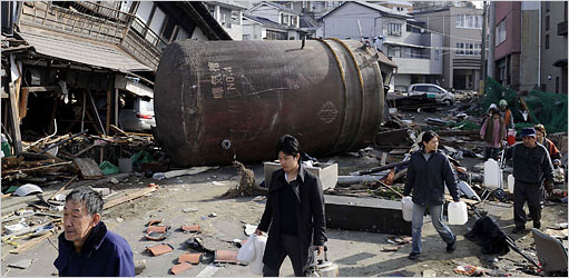 People walked through street rubble to a water supply in Kesennuma, Miyagi Prefecture, on Monday.