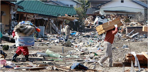 Residents of Toyoma carried belongings from their homes on Monday.