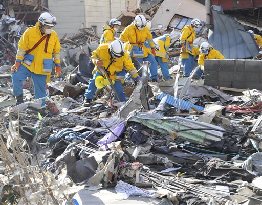 Police officers from Hyogo Prefecture search missing persons in the rubble in Kamaishi, Iwate Prefecture, northern Japan Monday.
