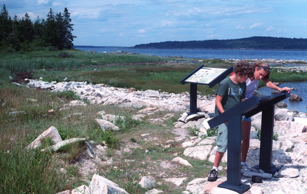 Jesse Groening (left) and his sister Cassedy Groening inspect a sign at the Petit Manan National Wildlife Refuge in Milbridge in the summer of 2000. The refuge includes two trails that offer hikers coastal views.