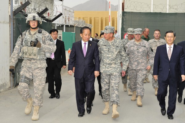 SFC Blaine Mahi from the 1136th Transportation Company, Maine Army National Guard, provides a security escort for the Minister Of Defense of Korea with Gen. Petraeus.