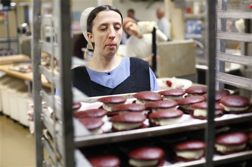 An Amish baker who declined to be identified moves a sheet of whoopie pies at the Bird-in-Hand Bakery in Bird-in-Hand, Pa. Maine and Pennsylvania have cooked up a good-natured tug-of-war over which place is the rightful home of this culinary creation.