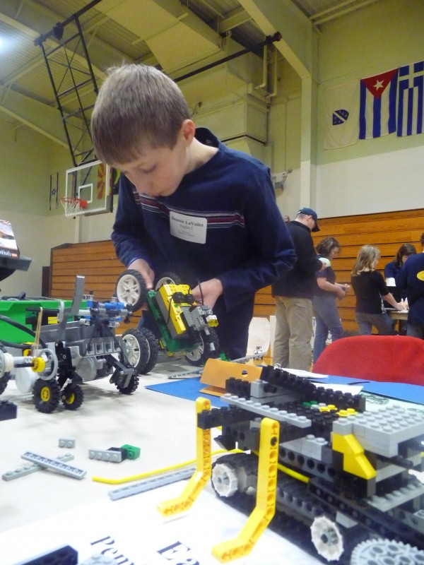 Donnie LaVoilet, 11, of Pembroke Elementary School, puts the final touches on his robot entry at Saturday's Washington County 4-H Robotoics Expo. Twenty teams from 7 schools attended the event, illustrating problem-solving skills, technology and teamwork. The event was sponsored by 4-H, The University of Maine Cooperative Extension and the Perloff Foundation.