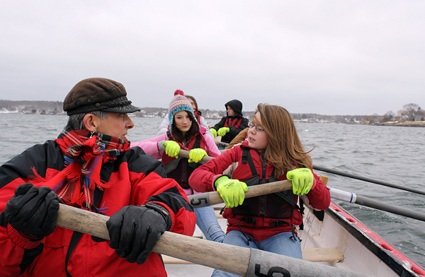 Muriel Curtis, the director of Station Maine, directs six teenagers around Rockland Harbor. The Rockland District Middle School students row each week as part of their school curriculum.
