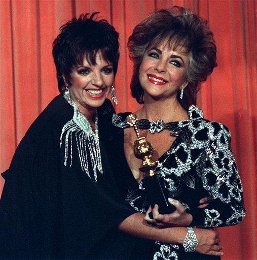 Liza Minelli, left, hugs  Elizabeth Taylor, who holds her Cecil B. DeMille award in Beverly Hills, Calif., in 1985.