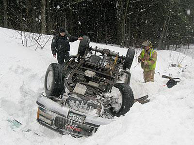 Brunswick police and rescue workers oversee extrication of a truck that flipped Monday, Feb. 28, 2011, on Route 1 in Brunswick.