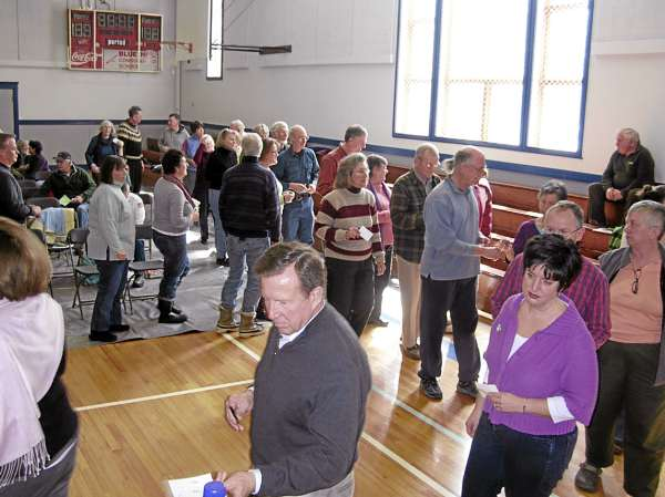 Blue Hill residents cast their ballots on the town budget Saturday during the annual town meeting.