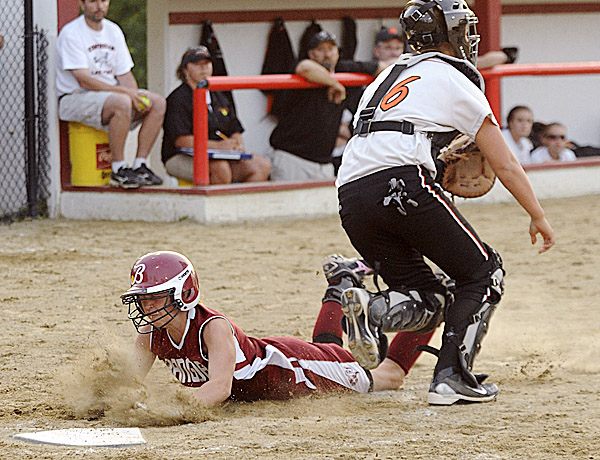 Bangor High School's Sadie Redman dives safely to home plate as Skowhegan High School catcher Sam Gray waits for the late throw during last season's Eastern Maine final. Bangor won the EM final last season and is hoping to contend again, as is crosstown rival Brewer, in a balanced Class A.