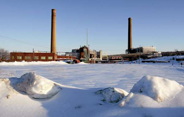 In this Tuesday, March 8, 2011 photo, a paper mill sits idle in Millinocket, Maine. The town's population has shrunk from 7,000 to 5,000 in recent years so the public high school is recruiting foreign students in an effort to keep up their numbers and to avoid cuts in programs.