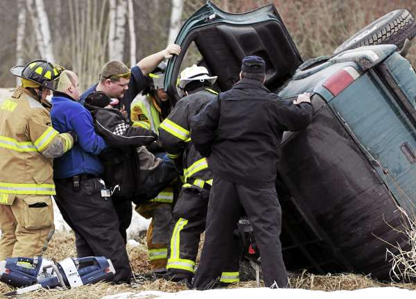 James Green of Hermon, center, is helped from his inverted SUV by rescue personnel from the Hermon and Levant fire department on the Fuller Road in Hermon on Monday, March 4, 2011. According to Penobscot Sherrif Deputy Michael Parady, Green was headed home from his auto body repair shop when the accident occured. &quot I suspect it's an OUI .&quot Parady added before leaving to administer a blood test to Green at the hospital.