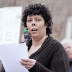 "Food and Medicine board secretary and University of Maine student  Jennifer Zabko joined several other speakers for the "" We Are One Rally for Human Dignity"" at the University of Maine's Dr. Martin Luther King, Jr. and Coretta Scott King Memorial Plaza Monday afternoon, April 4, 2011. The event also marked the anniversary of Dr. King's assassination in 1968 in Memphis,TN where he was supporting sanitation workers. The participants at Monday's rally focused on worker rights and human dignity."