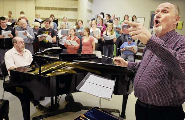 Conductor Ludlow Hallman (right) leads the combined choir with accompaniest Clayton W. Smith (at piano) for &quotMarie-Magdeleine&quot during rehearsal Monday evening at the University of Maine. The Bangor Symphony Orchestra, local soloists, UMaine Oratorio Society and the University Singers are collaborating for the production.