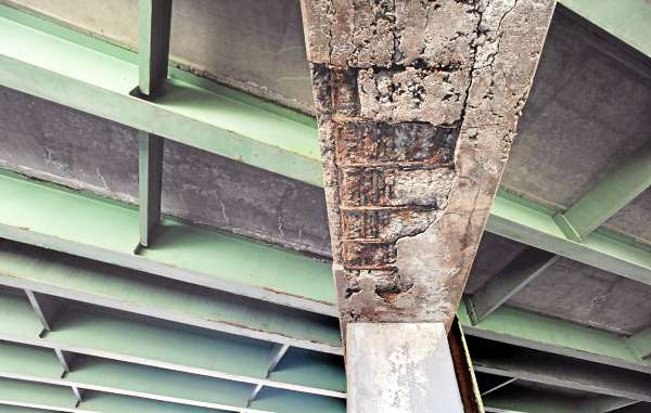 A crumbling support of the I-395 bridge that spans over the discontinued section of Webster Avenue in Bangor.