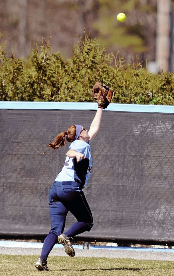 The University of Maine's Cassie Hodgson can't make the catch on a fly ball during first inning against Stony Brook in Orono Sunday. Stony Brook won 9-5.