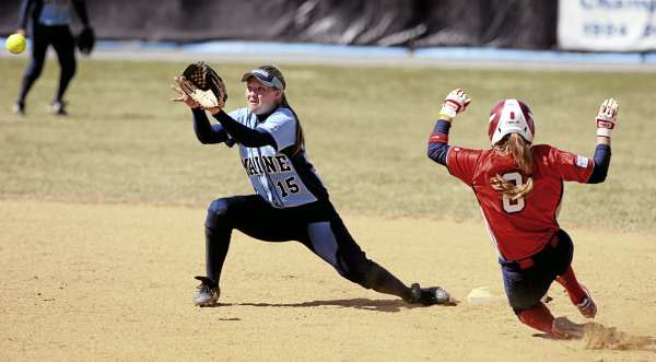 The University of Maine's Jennifer Eberhardt waits for the ball as Stony Brook's Suzanne Karath slides in safely at second base during the third inning in Orono Sunday. Stony Brook won 9-5.